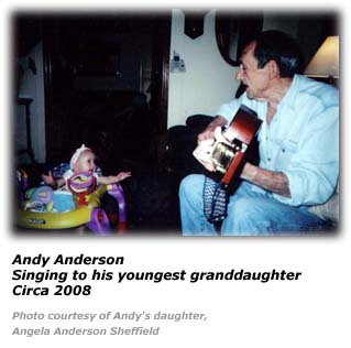 Andy Anderson sings to his granddaughter